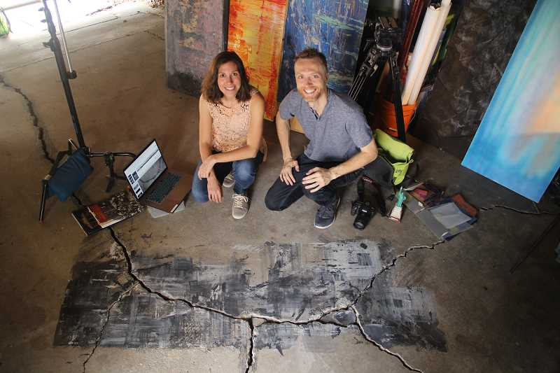 SUBMITTED PHOTO - Rachel Allen, left, and Perry Freeze of Z frame Studio work on a projection design for 'Ellis Island: The Dream of America,' which aired on PBS as part of their Great Performances series.