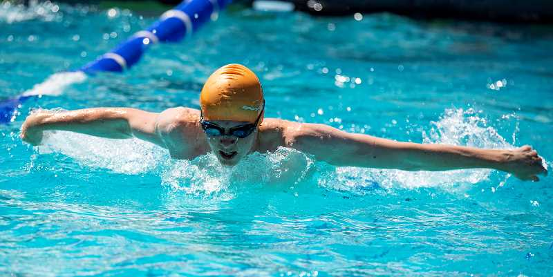 LON AUSTIN/CENTRAL OREGONIAN - Garrett McMichael competes in the boys 15-18 100-meter butterfly. McMichael finished second in the race to teammate Emilio Todd, but won high-point honors for the division with 41 points in the meet.
