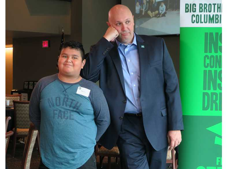 "COURTESY: BIG BROTHERS BIG SISTERS COLUMBIA NORTHWEST - Randall Rene poses with his ""Little,"" Henry, at the June 20 award ceremony for Oregon's Big Brother of the Year. ""We like to joke around a lot,"" Rene said of his relationship with Henry."