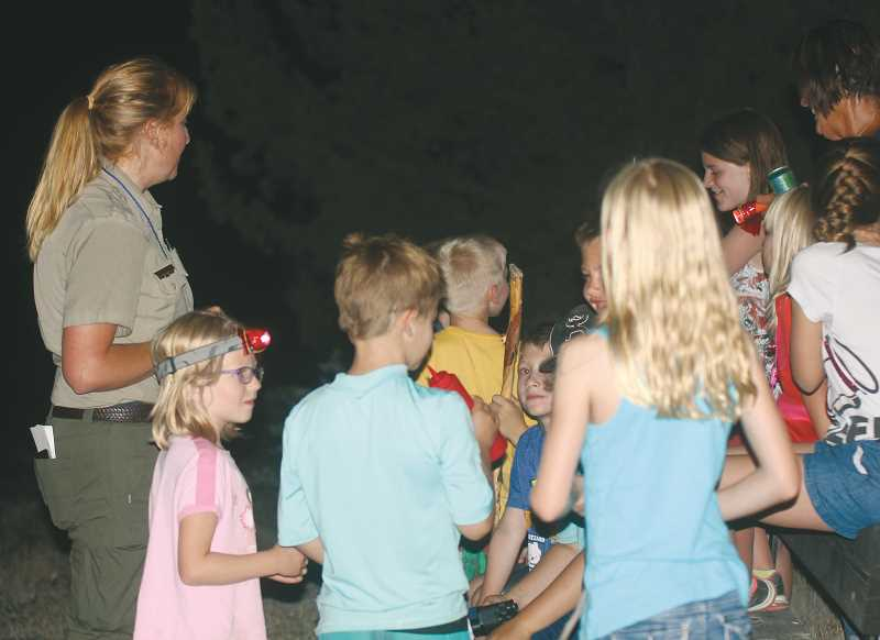 STEELE HAUGEN - Park ranger Erin Bennett leads a night hike at the Cove Palisades.