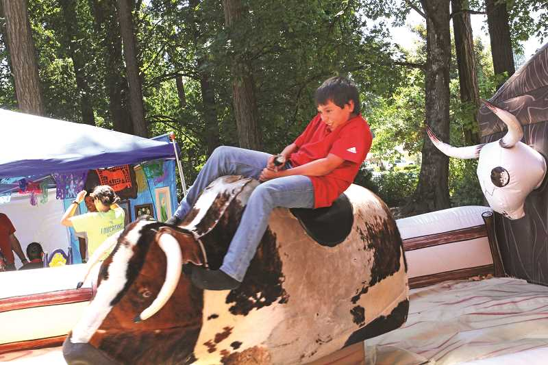 INDEPENDENT FILE PHOTO - A free mechanical bull has been a fun addition to Fiesta Mexicana for the past few years.