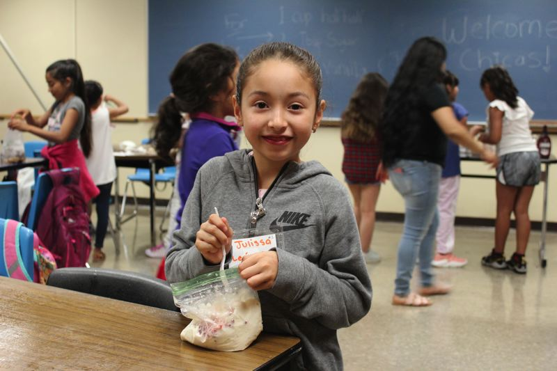 STAFF PHOTO: OLIVIA SINGER - Third grader Julissa Leon-Sandoval participated in ice cream making during the STEM camp, where the girls also learned the science behind it.