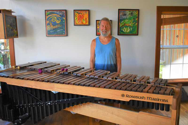 ESTACADA NEWS PHOTO: EMILY LINDSTRAND - Peter Bush stands next to a marimba he created. Bush makes marimbas for schools and other customers.