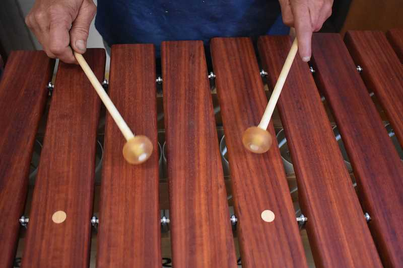 ESTACADA NEWS PHOTO: EMILY LINDSTRAND - Peter Bush plays one of his marimbas.