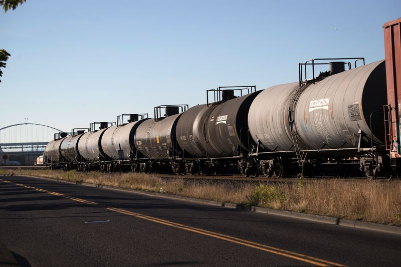 TRIBUNE FILE PHOTO  - Oil tanker train cars sit idle next to the oil terminals in Northwest Portland. A city fossil fuel ordinance barring major expansions of those terminals survived a challenge to the Oregon Supreme Court.