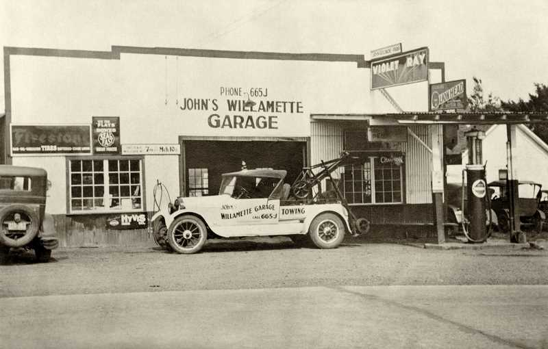 PHOTO COURTESY OLD OREGON PHOTOS - .John Goldade and his wife purchased this service station at 7th Avenue and 12th Street in 1927. Originally owned by Herman and Mike Peter, it was Willamette's first service station when they opened it in 1920.
