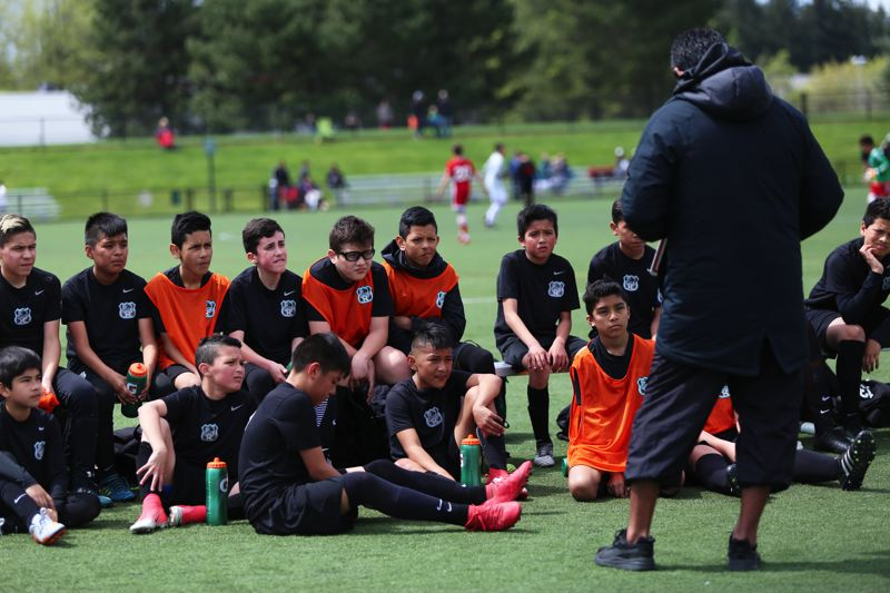 PAMPLIN MEDIA GROUP PHOTO: JESSIE DARLAND - While some youth soccer teams treat the halftime breaks as free time, Cuervos players get instructions on how to improve and find their opponents weak points.