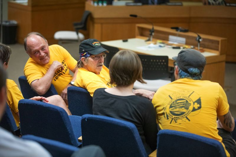 TRIBUNE PHOTO: JONATHAN HOUSE - Members of ATU 757 sit in the audience of a July 24 Portland Public Schools board meeting. The special education drivers are threatening to strike.