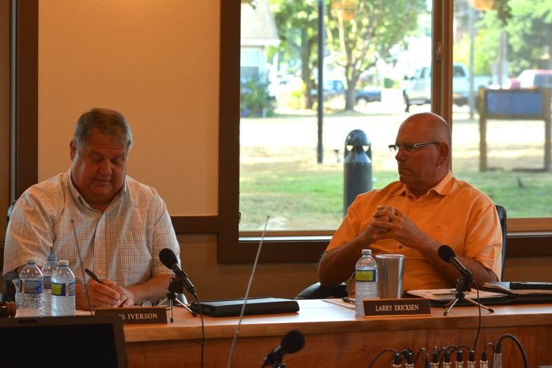 SPOTLIGHT PHOTO: COURTNEY VAUGHN - Port of Columbia County Commissioner Chris Iverson (left) gives his pick for an applicant review committee member during a meeting July 25. To his right, Commissioner Larry Ericksen listens.