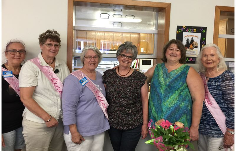 COLUMBIA COUNTY RSVP PHOTO - Terri Green (center) is named volunteer of the month by Columbia County RSVP. Pictured left to right: My Fair lady Princess Patty St. John, Queen Carla Bodenhamer ; Princess Sharon Brown, Green, RSVP Director Monica Cade, and Princess Jeanne Kangas.
