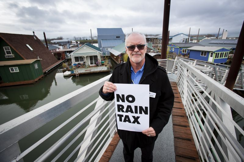 TRIBUNE FILE PHOTO: JAIME VALDEZ - Jantzen Beach floating home owner Ron Schmidt mobilized fellow houseboat residents to oppose a new stormwater billing method by the city that he dubbed a 'rain tax,' because it assessed residents based on rainwater falling on houseboat roofs.