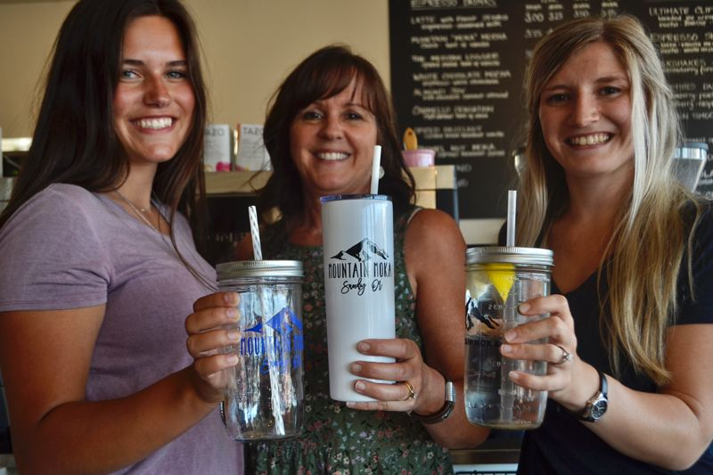 PAMPLIN MEDIA GROUP: BRITTANY ALLEN - Tina Hovey, owner of Mountain Moka (pictured middle), supplies reusable tumblers and mugs for her employees to use to cut down on waste.