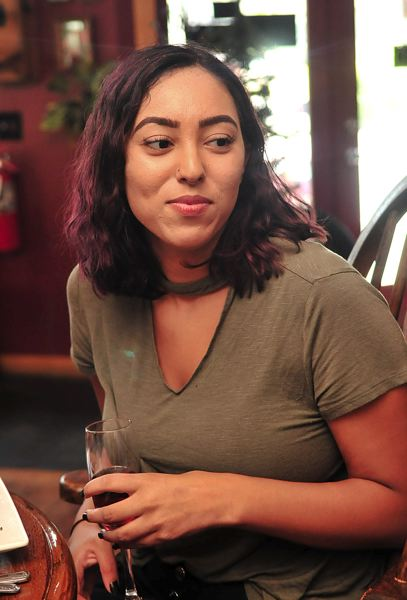 PAMPLIN MEDIA GROUP: VERN UYETAKE  - Springdale resident Alicia Michelson talks about her preference to not use straws for her drinks on Tuesday, July 31, at Troutini in downtown Troutdale. Michelson said she never uses a straw to enjoy a beverage.