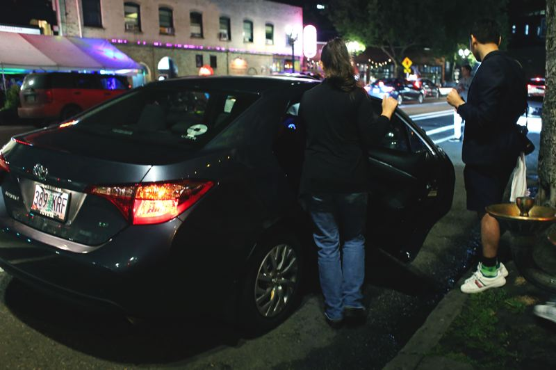 TRIBUNE FILE PHOTO: JESSIE DARLAND - A passenger gets a lift from Uber after a night out in Portland's Old Town/Chinatown.