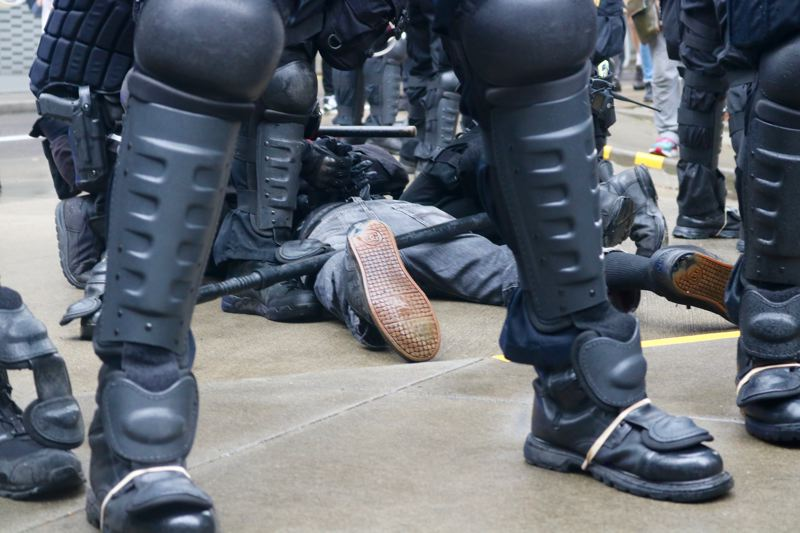TRIBUNE PHOTO: ZANE SPARLING - A person is arrested during the a street protest involving Antifa and Patriot Prayer earlier this year in downtown Portland.