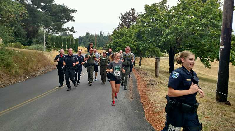 PHOTO COURTESY OF ALAN PAINTER - Law enforcement officials and firefighters compete in their own division during the Ralph Painter Memorial Run, most competing in full uniform. This year, for the second year in a row, Longview Police Department secured the police and fire competition plaque.