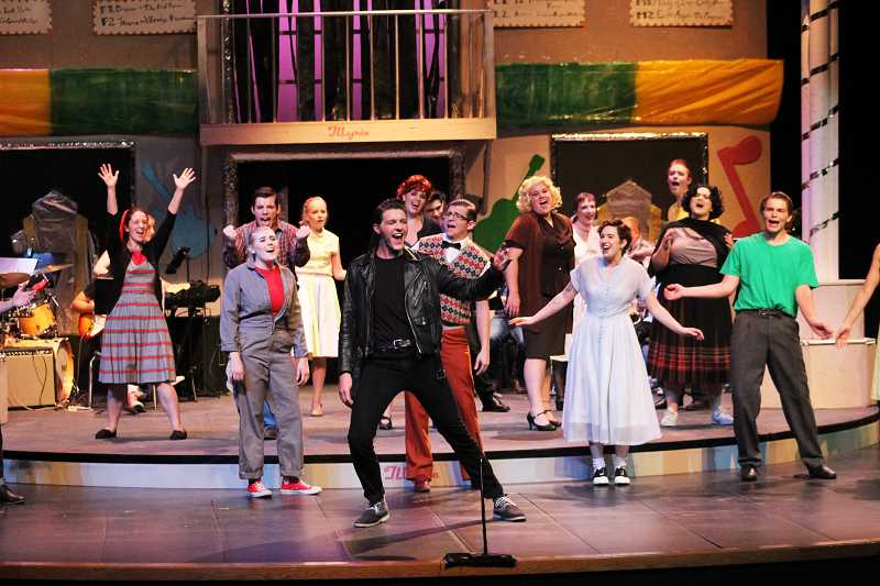 HERALD PHOTO: KRISTEN WOHLERS - Cade Holbrook as Chad (center) leads the cast of 'All Shook Up' in song.