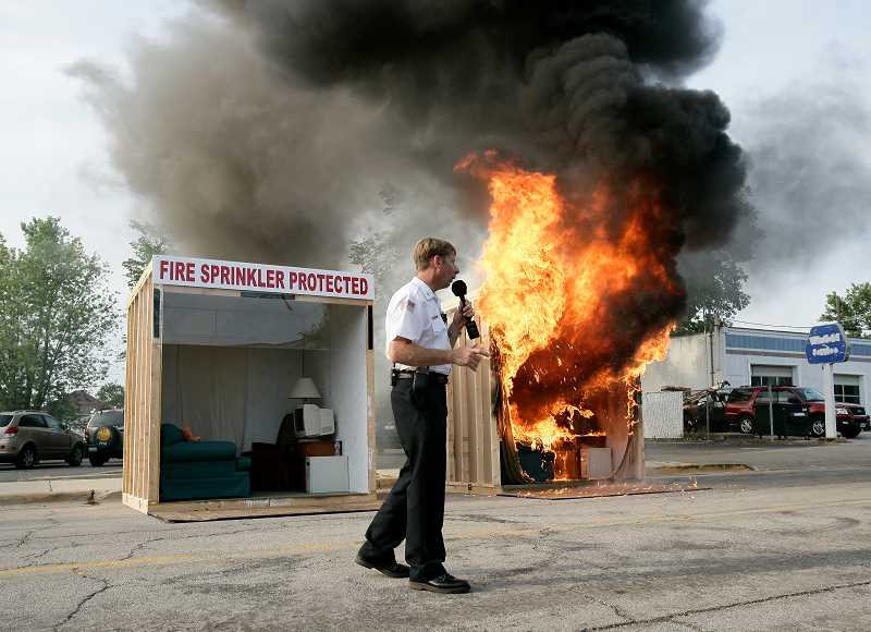 COURTESY PHOTO: HOME FIRE SPRINKLER COALITION - Pictured is a side by side burn demonstration.