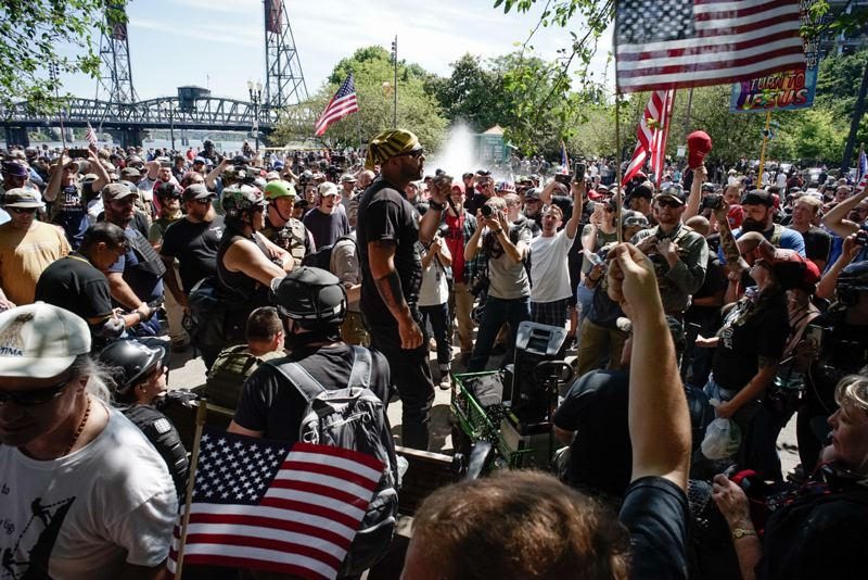 TRIBUNE PHOTO: KIT MACAVOY - Patriot Prayer leader and Washington State U.S. Senate candidate Joey Gibson speaks near the end of a protest on Saturday, August 4 near the Salmon Street Springs fountain in downtown Portland.