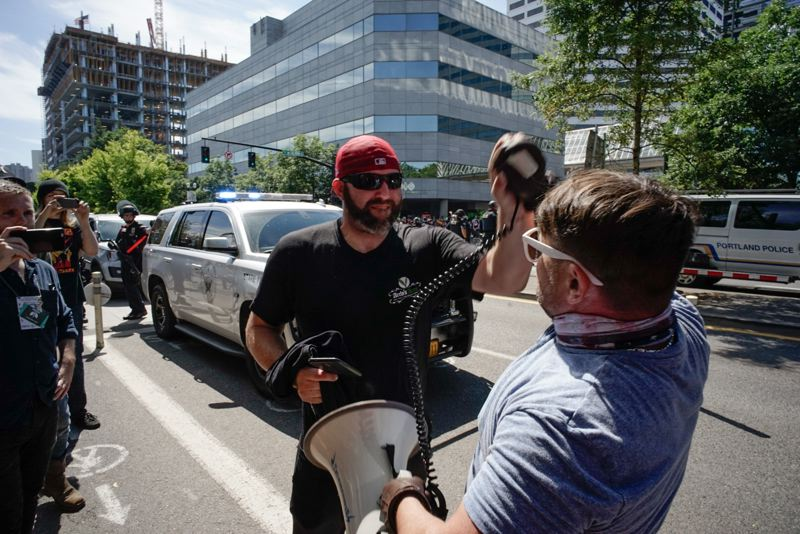 TRIBUNE PHOTO: KIT MACAVOY - Two protesters skirmish during the Patriot Prayer and Antifa rally on Saturday, August 4 in Portland.