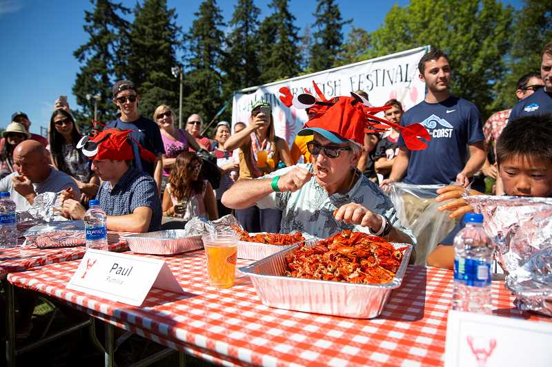 PAMPLIN MEDIA GROUP: ADAM WICKHAM - Dr. Paul Pumilia, M.D. polished off three pounds of  crawfish in seven minutes, becoming this years crawfish-eating winnr.