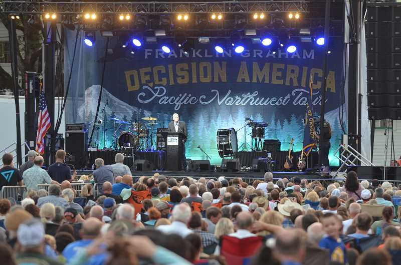 HERALD PHOTO: KRISTEN WOHLERS - Franklin Graham preaches to a crowd of more than 12,000 people at Clackamas County Fairgrounds and Event Center in Canby, Oregon on Sunday, Aug. 6.