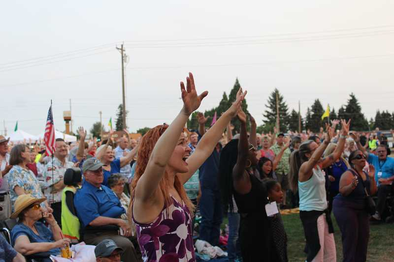 HERALD PHOTO: KRISTEN WOHLERS - Crowds in Canby raise their hands and sing along to songs by Christian band, The Afters.
