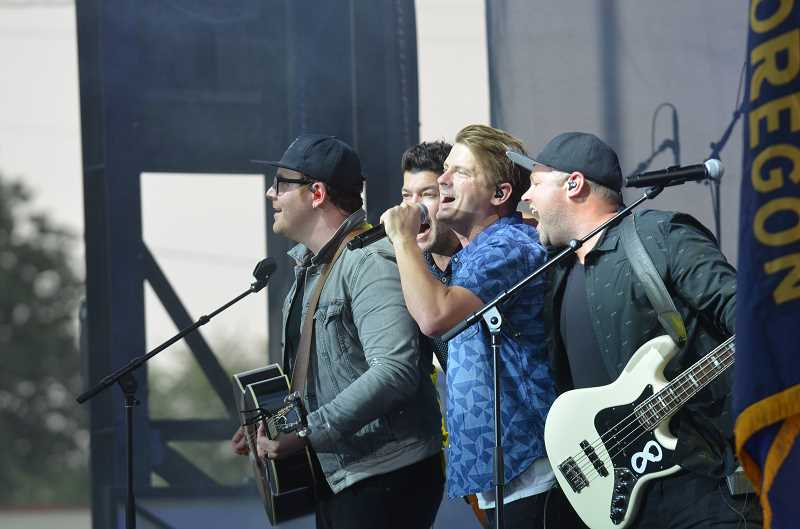 HERALD PHOTO: KRISTEN WOHLERS - The Afters perform before evangelist Franklin Graham takes the stage.