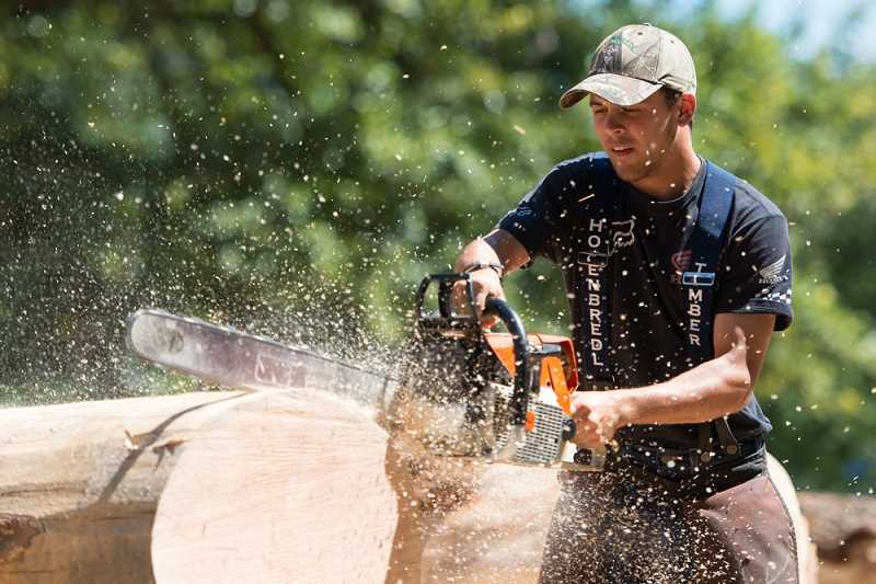 STAFF PHOTO: CHRISTOPHER OERTELL - Vernonia held a logging show at Hawkins Park on Sunday where participants competed in several contests including log cutting and axe throwing.