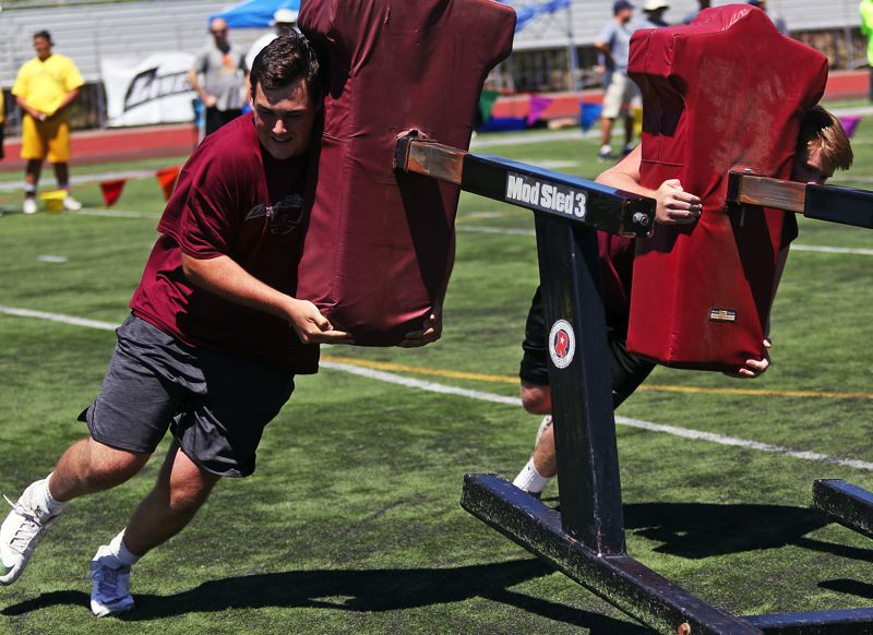 TIMES PHOTO: DAN BROOD - Tualatin senior-to-be Quinn McCarthey helped the Wolves take second place in the two-man blocking sled relay event at the Metro Area Lineman Challenge.