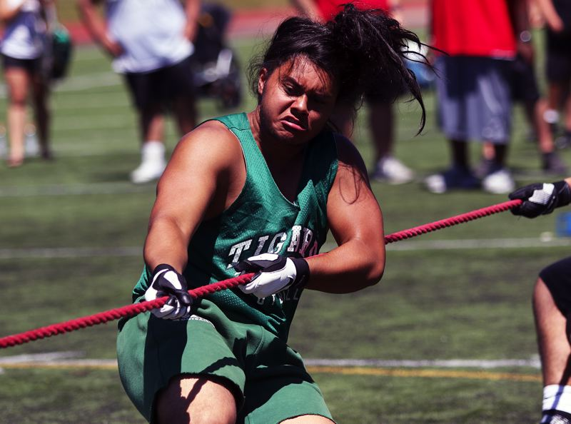 TIMES PHOTO: DAN BROOD - Isaia Tavita Porter, a Tigard High School senior to be, helped the Tigers power to first place in the team tug-of-war at the Metro Area Lineman Challenge.