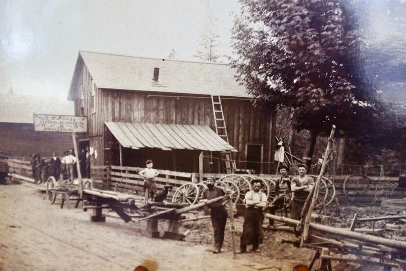 OUTLOOK PHOTO: CHRISTOPHER KEIZUR - Director Matt Holland's favorite photo in the collection is of C.C. Millers blacksmith shop, later known as Gresham General Blacksmithing, which was taken in 1892. 7