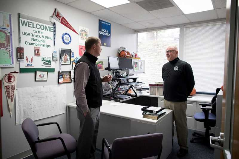 PAMPLIN MEDIA GROUP: JAIME VALDEZ - Peter Weber, executive director of the Oregon School Activities Association (left), and assistant director Brad Garrett say it wasn't until a decade ago that sports officials started getting serious about concussions.