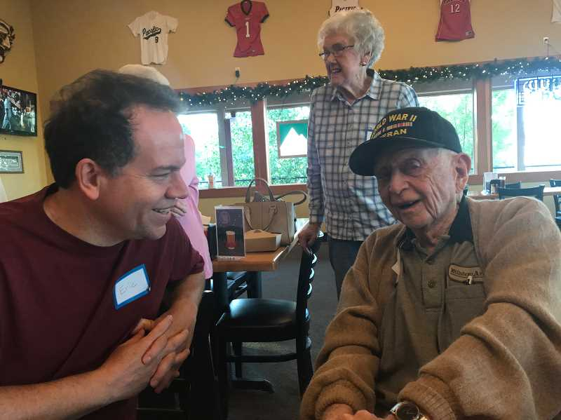 STAFF PHOTO: GEOFF PURSINGER - Former Hillsboro Argus reporter Eric Apalategui, left, chats with former Argus publisher Walter McKinney on Tuesday, July 31. Staff at the former Hillsboro newspaper still meet regularly to reminisce.