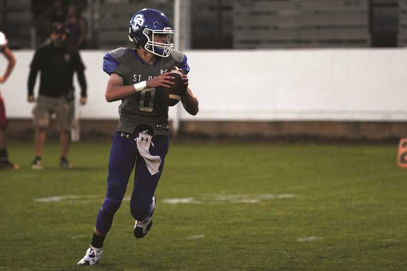 PHIL HAWKINS - Holden Smith earned 2A 2nd Team All-State honors at quarterback last year, and was joined in Baker City by his father Tony Smith, who ran the offense for the West Team at the East West Shrine Game.