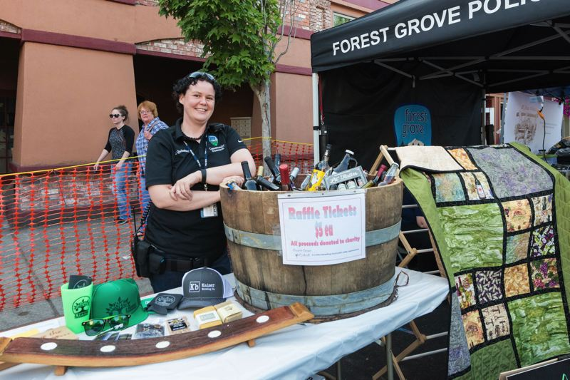 STAFF PHOTO: CHRISTOPHER OERTELL - Lauren Quinsland, a community outreach specialist with the Forest Grove Police Department, stands by last year's Forest Grove UnCorked raffle prize. Proceeds from the UnCorked raffle and a portion of admission fees go toward a public safety charity every year.