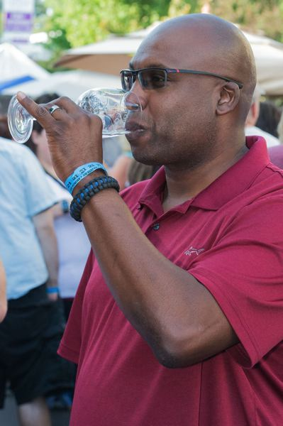 STAFF PHOTO: CHRISTOPHER OERTELL - Kevin Hale tastes some wine during last year's Forest Grove UnCorked festival.