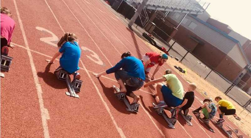 SUBMITTED PHOTO - A group of MHS running camp members practice using the starting blocks.