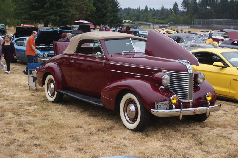SUBMITTED PHOTO - Roy and Judy Burge of Milwaukie showed off their stunning 1939 Pontiac at last year's Hot Dog-Ust Day Cruise-In and Car Show.