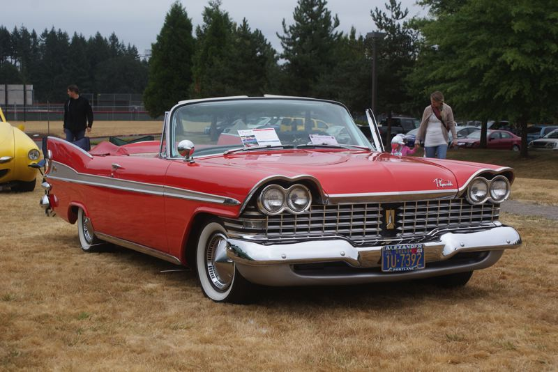 SUBMITTED PHOTO - Eric Eichelberg of Damascus made quite an impression with his 1959 Plymouth convertible at the Clackamas Community College car show last year.