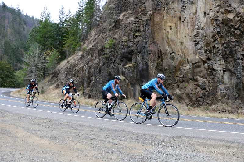 CONTRIBUTED PHOTO: PHIL LINGELBACH - Cyclists ride along a stretch of the Cascading Rivers Scenic Bikeway, the site of several upcoming bike rides that begin in Estacada.