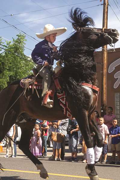 PATRICK EVANS - The Fiesta Mexicana parade featured dozens of entries, including a skilled horse and young rider who danced along the route Saturday.