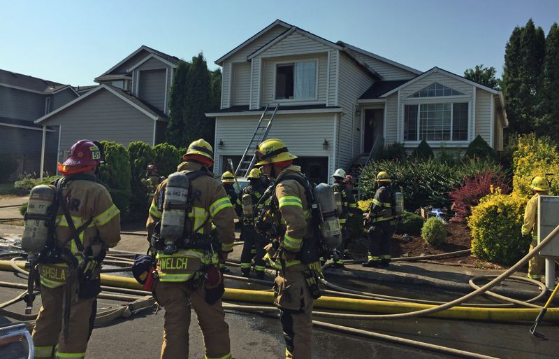 PHOTO COURTESY TVF&R - Firefighters respond to a Tuesday, Aug. 7, house fire in Bethany.