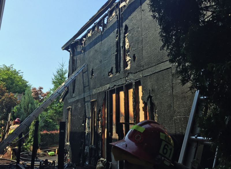 PHOTO COURTESY TVF&R - The exterior of the home was damaged by the fire.