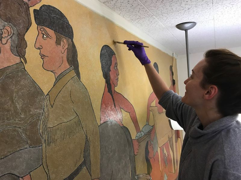 COURTESY HERITAGE CONSERVATION GROUP - A worker restores 'A Pageant of Oregon History' inside the former library of Abernethy Elementary School in Portland.
