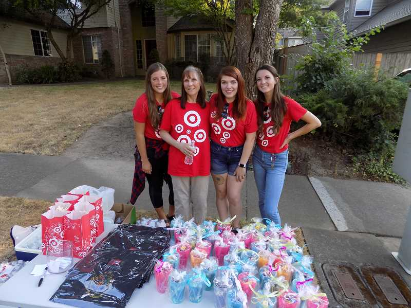 TIMES PHOTO: RAY PITZ - Employees from the Sherwood Target display some of items the store donated for the annual event.