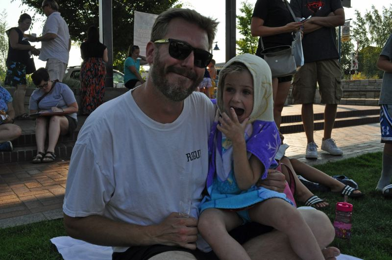 TIMES PHOTO: BLAIR STENVICK - Sherwood resident Josh Coleman and his daughter, Violett, attended Sherwood's National Night Out. 'I'm glad community still means something in some places,' Coleman said about the event.