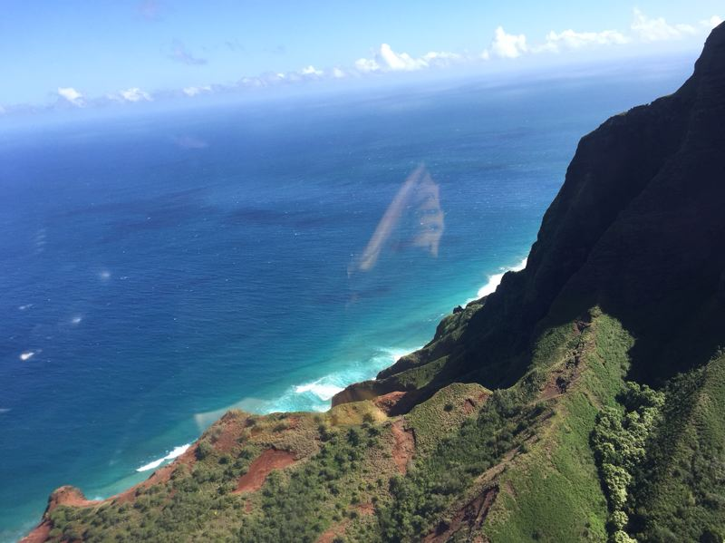 CONTRIBUTED PHOTO: LILA REED - Towering cliffs and a rich, velvety landscape make up the NaPali Coast of Kauai. The mountainous terrain drops sharply into the Pacific Ocean on the north side of the island.