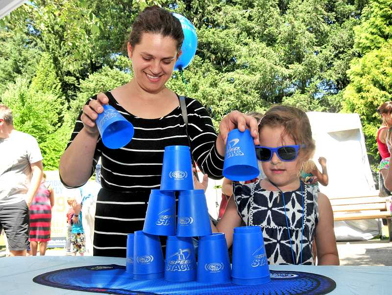 Wilsonvilles Lidiyia, left, and Amy Inzhirov have fun stacking cups