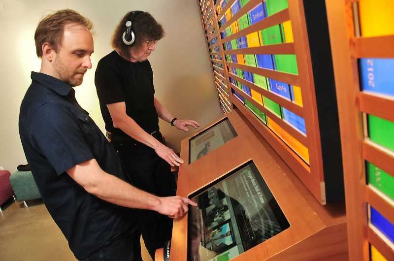 The display features interactive kiosks with information on inductees and audio samples of their work.